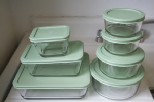 I bought several sets of these inexpensve glass storage containers.