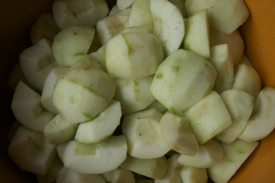 quartered-apples-orange-bowl-close